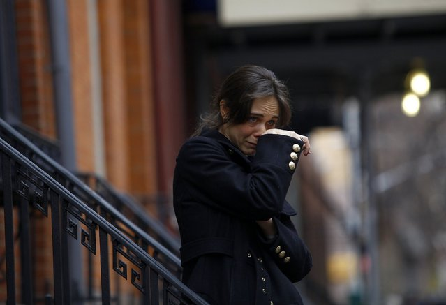 A woman who declined to give her name and said she was friends and working on a project with movie actor Philip Seymour Hoffman wipes away tears as she stands across the street from the apartment where they found the celebrity dead in New York February 2, 2014. Award-winning actor Hoffman was found dead in his New York City apartment on Sunday of an apparent drug overdose, according to a New York Police Department source. (Photo by Joshua Lott/Reuters)