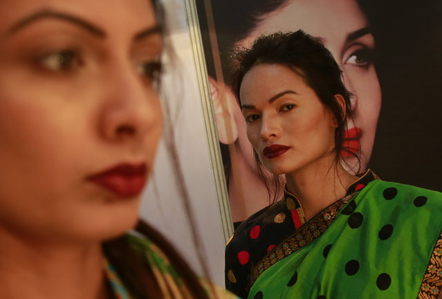 In this February 2, 2017 photo, Anjali Lama, a transgender model from Nepal, stands backstage at the Lakme Fashion week in Mumbai, India. Growing up as the fifth son in a poor farming family in rural Nepal the dream to be a fashion model came late in life. First came a long, painful struggle to accept that he felt deeply female. It was a chance encounter with a group of transgender women that turned Lama's life around by putting her in touch with the Blue Diamond Society, an advocacy group for Nepal's LGBT community. In 2005 she came out to her friends and family as a transgender woman. (Photo by Rafiq Maqbool/AP Photo)