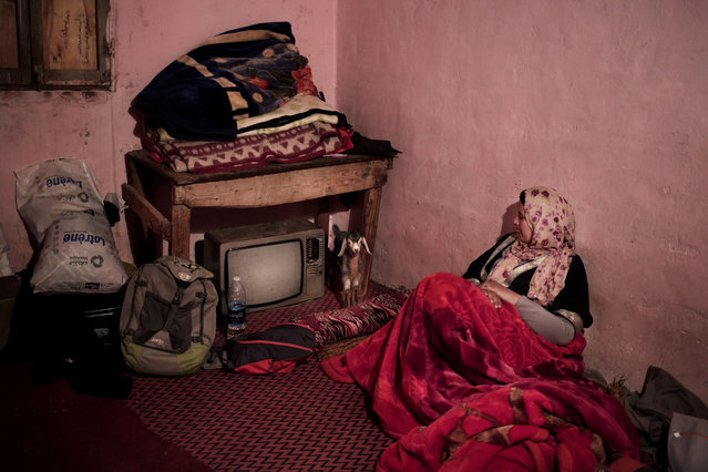 In this March 29, 2019 photo, Zahra looks at Yolanda the baby goat in Umm Yasser's home, in Wadi Sahw, Abu Zenima, in South Sinai, Egypt. (Photo by Nariman El-Mofty/AP Photo)