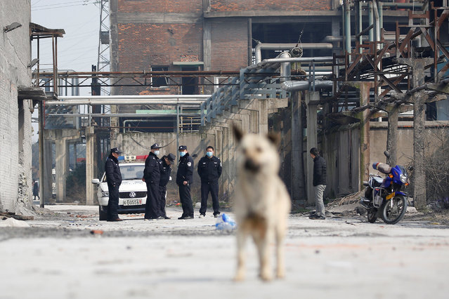 Police officers stand at the site of an explosion at a chemical plant in Tongling, Anhui province, China, February 9, 2017. (Photo by Aly Song/Reuters)