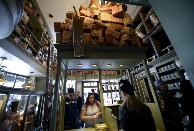 """Guests shop inside Dervish and Banges general store in Hogsmeade Village during a soft opening and media tour of """"The Wizarding World of Harry Potter"""" theme park at the Universal Studios Hollywood in Los Angeles, California in this picture taken March 22, 2016. (Photo by Kevork Djansezian/Reuters)"""