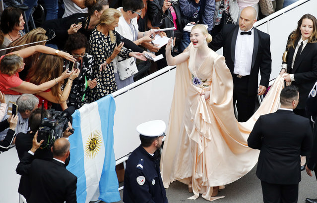 "American actress Elle Fanning arrives for the opening ceremony of the 72nd Cannes Film Festival and screening of the film ""The Dead Don't Die"" in Cannes, France on May 14, 2019. (Photo by Regis Duvignau/Reuters)"