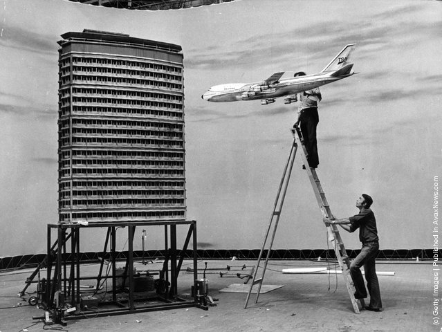 Film technicians at Pinewood Studios set up a miniature air crash sequence for the Jack Gold film The Medusa Touch, using scale models of a Boeing 747 and a skyscraper