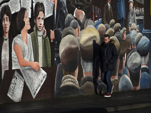 A man walks past a mural on the Falls Road a day after Northern Ireland's Deputy First Minister Martin McGuinness resigned, throwing the devolved joint administration into crisis, in Belfast Northern Ireland, January 10, 2017. (Photo by Clodagh Kilcoyne/Reuters)