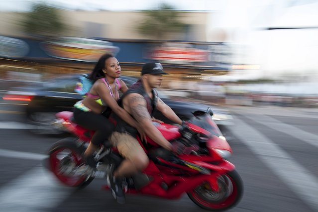 Bikers cruise down Ocean Boulevard during the 2015 Atlantic Beach Memorial Day BikeFest in Myrtle Beach, South Carolina May 24, 2015. (Photo by Randall Hill/Reuters)