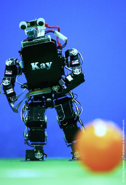 Humanoid robots of the children size league compete during the RoboCup 2006 football world championships