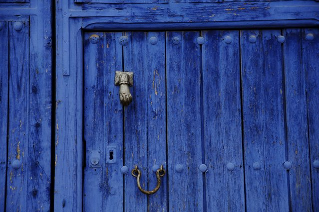 A door painted in the traditional indigo Manchegan style is seen in the hometown of Don Quixote's ladyship Dulcinea, in El Toboso, Spain, April 6, 2016. (Photo by Susana Vera/Reuters)