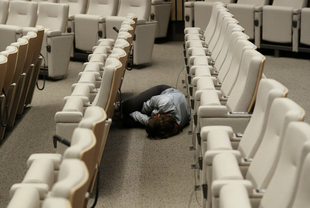 A journalist sleeps while waiting for the end of a European Union leaders summit that aims to select candidates for top EU institution jobs, in Brussels, Belgium on July 1, 2019. (Photo by Yves Herman/Reuters)