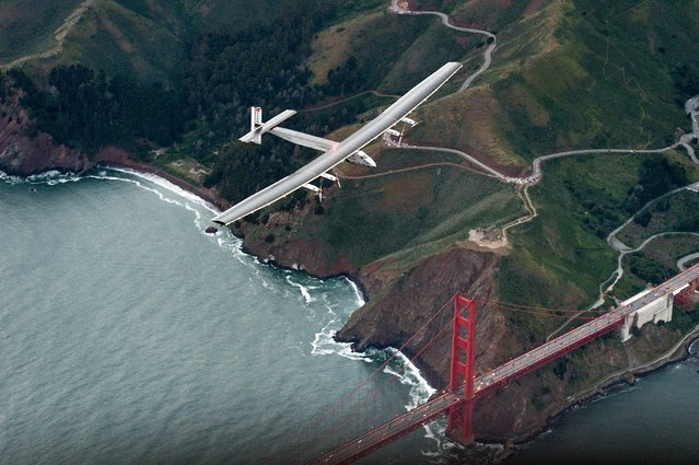 Solar Impulse 2 flies over the Golden Gate Bridge in San Francisco, Saturday, April 23, 2016. (Photo by Noah Berger/AP Photo)