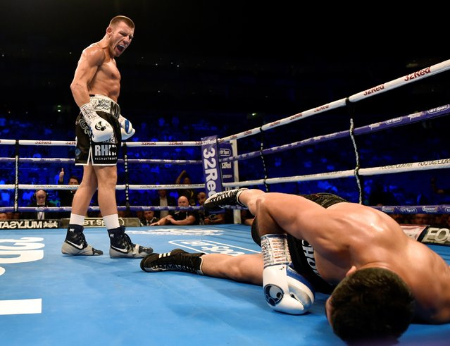 Liam Williams (L) knocks down Karim Achour during the WBC Silver Middleweight Championship at the O2 Arena, London on July 13, 2019. (Photo by Adam Holt/Action Images via Reuters)