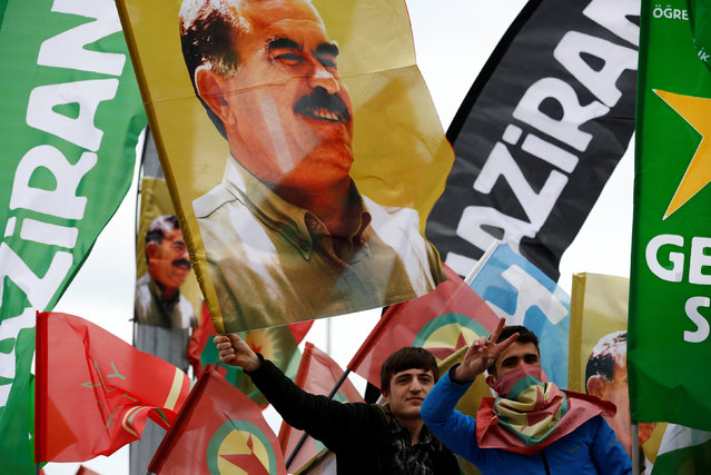 People wave flags with pictures of imprisoned Kurdish rebel leader Abdullah Ocalan during a May Day rally in Istanbul, Turkey May 1, 2016. (Photo by Murad Sezer/Reuters)