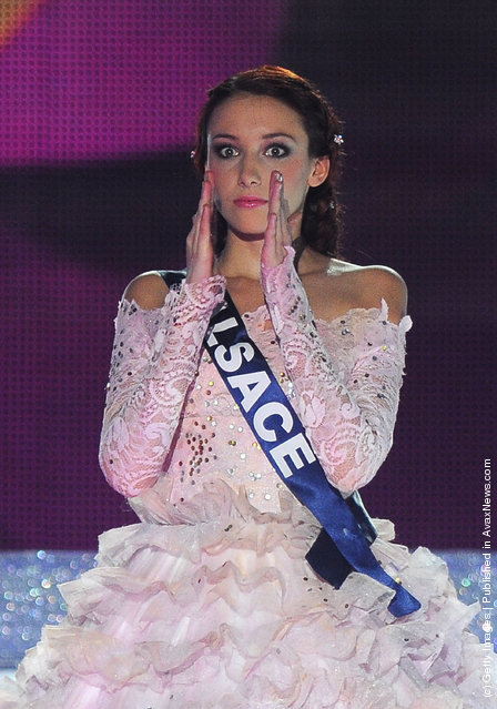 Delphine Wespiser reacts as she celebrates being crowned Miss France 2012 on stage