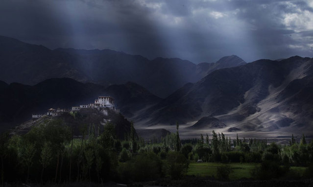 Sun painting a monastery and the surrounding Ladakh landscape. Ladakh, India. (Photo by Porus Khareghat/Smithsonian.com)