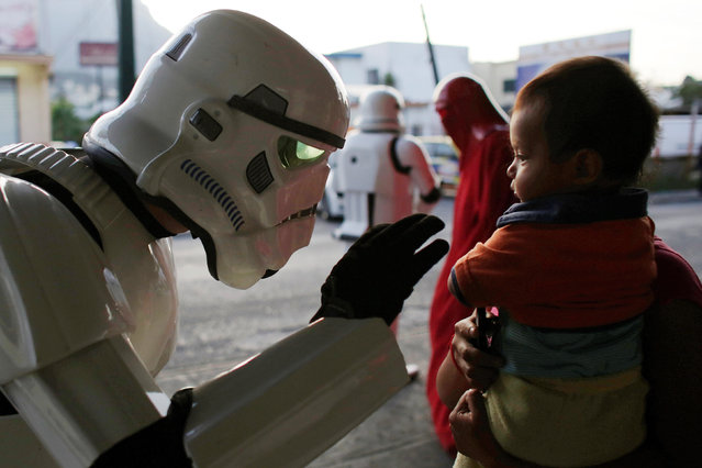 A member of the Star Wars fan club, dressed as a Stormtrooper, talks to a girl outside a hospital's emergency ward during Star Wars Day celebrations in Monterrey, Mexico May 4, 2016. (Photo by Daniel Becerril/Reuters)