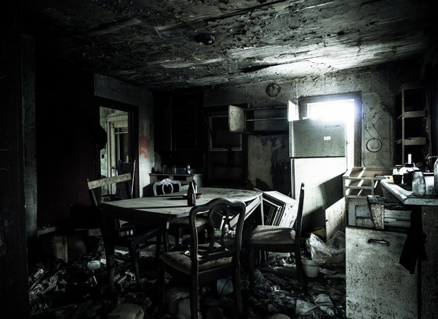 """The damaged kitchen inside the country home known as the """"Safety Brick"""", Ohio. (Photo by Jonny Joo/Barcroft Media)"""