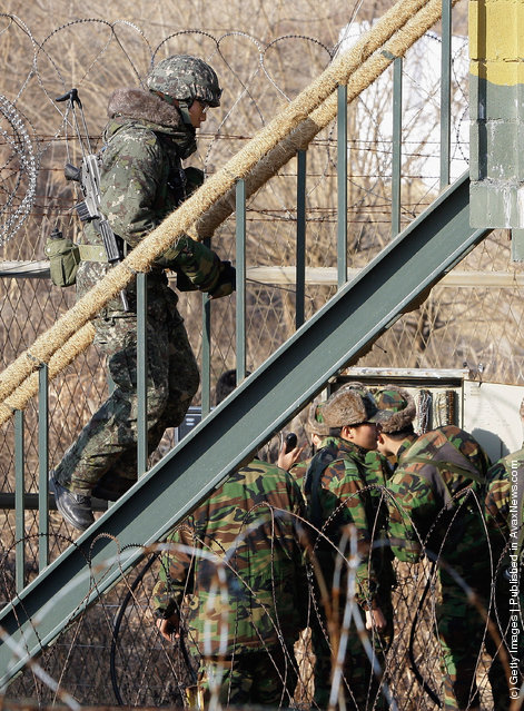 South Korean soldiers patrol inside the barbed-wire fence at Imjinkak, near the Demilitarized zone (DMZ) separating South and North Korea