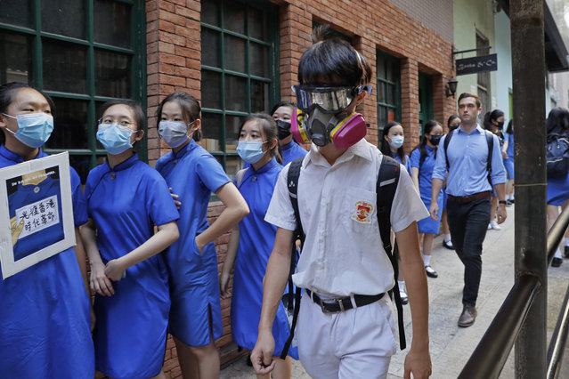 Students wearing mask hold hands to surround the St. Stephen's Girls' College in Hong Kong, Monday, September 9, 2019. (Photo by Kin Cheung/AP Photo)