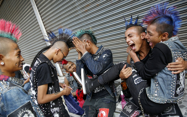 Myanmar punks take part in a punk gathering ahead of the Thingyan water festival in Yangon, Myanmar, 12 April 2017. (Photo by Lynn Bo Bo/EPA)