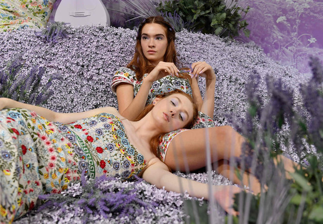Models pose during the alice + olivia by Stacey Bendet Spring 2020 Fashion Presentation at Root Studio during New York Fashion Week: The Shows on September 9, 2019 in New York City. (Photo by Angela Weiss/AFP Photo)