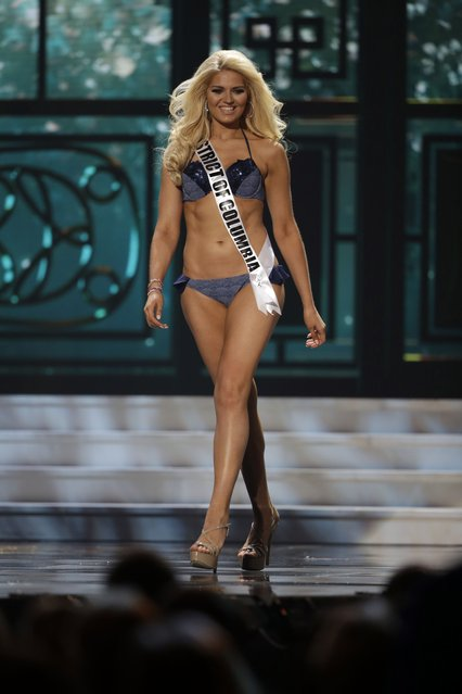 Miss District Of Columbia, Lizzy Olsen, competes in the bathing suit competition during the preliminary round of the 2015 Miss USA Pageant in Baton Rouge, La., Wednesday, July 8, 2015. (Photo by Gerald Herbert/AP Photo)