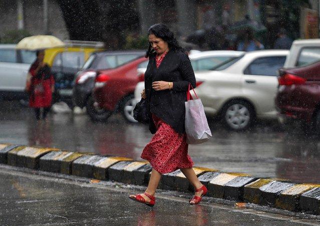 A woman crosses a road as it rains in Mumbai, India, September 20, 2019. (Photo by Hemanshi Kamani/Reuters)