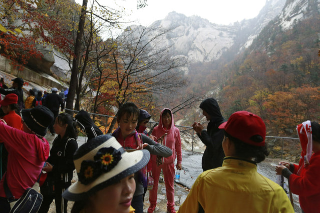 In this October 23, 2018, file photo, tourists visit Mount Kumgang in North Korea. U.S. President Donald Trump and North Korean leader Kim Jong Un will likely be all smiles as they shake hands later this week in Hanoi for a meeting meant to put flesh on what many critics call their frustratingly vague first summit in Singapore. But behind the grins is a swirl of competing goals and fears. (Photo by Dita Alangkara/AP Photo)