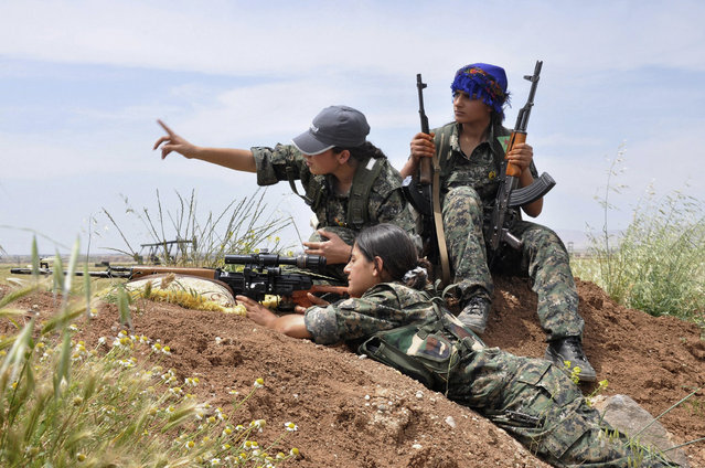 Kurdish female fighters of the Women Protection Unit (YPJ) attend military training near Qamishli city May 11, 2014. (Photo by Massoud Mohammed/Reuters)