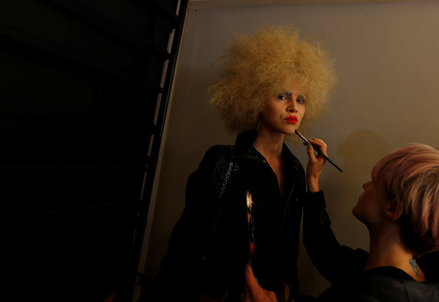 A model has her make-up re-touched backstage before a fashion show for the label Romance Was Born on the waterfront of Sydney Harbour during Australian Fashion Week, Sydney, Australia May 18, 2016. (Photo by Jason Reed/Reuters)
