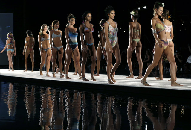 Models walk down the runway during the San Lorenzo Bikinis swimwear show as part of Funkshion Fashion Week Swim, Saturday, July 18, 2015, in Miami Beach, Fla. (Photo by Lynne Sladky/AP Photo)