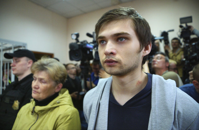 "Russian blogger Ruslan Sokolovsky and his mother Yelena Chingina, left, listen to a sentence in a court in Yekaterinburg, Russia, on Thursday, May 11, 2017. Sokolovsky has been convicted for inciting religious hatred for playing ""Pokemon Go"" in a church and given a suspended sentence. (Photo by Alexei Bulatov/Komsomolskaya Pravda photo via AP Photo)"