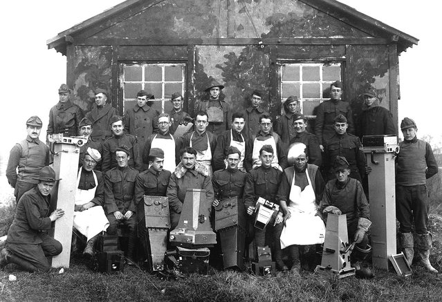 "14th Photo Section, 1st Army, ""The Balloonatic Section"". Capt. A. W. Stevens (center, front row) and personnel. Ca. 1918. Air Service Photographic Section. (Photo by Army Air Forces via The Atlantic)"