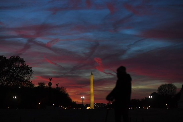 Colors fill the sky around the Washington Monument at sunset in D.C. on November 13, 2019. (Photo by Matt McClain/The Washington Post)