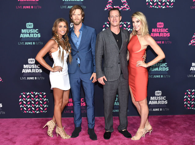 Brittney Marie Cole, Brian Kelley and Tyler Hubbard from musical group Florida Georiga Line and Hayley Hubbard attends the 2016 CMT Music awards at the Bridgestone Arena on June 8, 2016 in Nashville, Tennessee. (Photo by Mike Coppola/Getty Images for CMT)