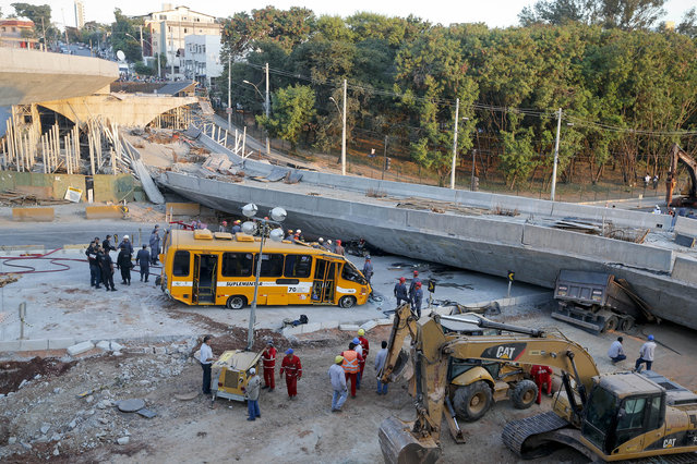 A bus sits damaged next to a bridge after it collapsed in Belo Horizonte, Brazil, Thursday, July 3, 2014. The overpass under construction collapsed Thursday in the Brazilian World Cup host city. The incident took place on a main avenue, the expansion of which was part of the World Cup infrastructure plan but, like most urban mobility projects related to the Cup, was not finished on time for the event. (Photo by Victor R. Caivano/AP Photo)