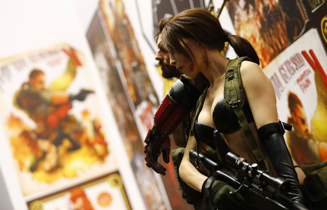 "Models promote the game ""Diamond Dogs"" during the Gamescom 2015 fair in Cologne, Germany August 5, 2015. (Photo by Kai Pfaffenbach/Reuters)"
