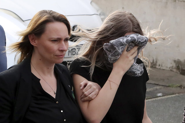 A 19 year-old British woman, right, that was found guilty of making up claims she was raped by up to 12 Israelis, arrives at Famagusta District Court with her mother for sentencing on Tuesday, January 7, 2020. A Cyprus court handed a four-month suspended sentence to a 19-year-old British woman who was found guilty of public mischief for making up claims that she was raped by up to a dozen Israelis. (Photo by Petros Karadjias/AP Photo)