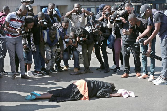 An injured protester lies on the road after clashes between Zimbabwe Republic Police (ZRP) and members of the public who took part in the Democratic Change (MDC) Alliance organised Peace March in Harare, Zimbabwe, 16 August 2019.The anti governemnt march is to protest against the cost of living, unemployment, power and fuel shortages among other issues. (Photo by Aaron Ufumeli/EPA/EFE/Rex Features/Shutterstock)