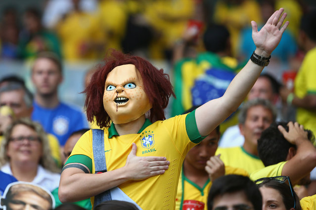 A Brazil fan enjoys the atmosphere prior to the 2014 FIFA World Cup Brazil Semi Final match between Brazil and Germany at Estadio Mineirao in Belo Horizonte, Brazil, on Jule 8, 2014. (Photo by Robert Cianflone/Getty Images)
