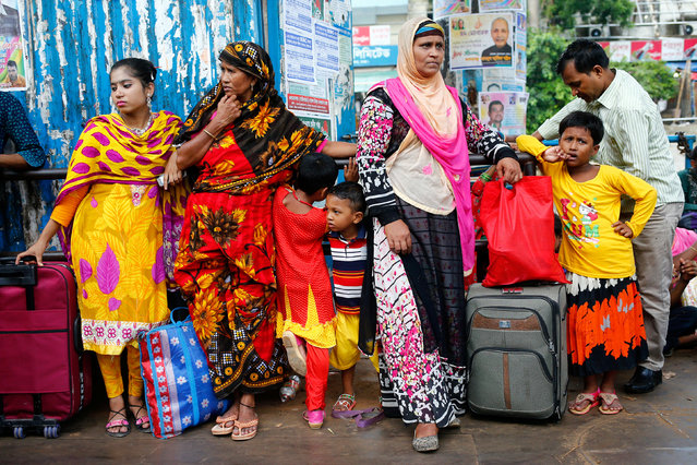 People wait to get on board at a ferry terminal as they travel home to celebrate Eid al-Fitr festival in Dhaka, Bangladesh June 23, 2017. (Photo by Mohammad Ponir Hossain/Reuters)