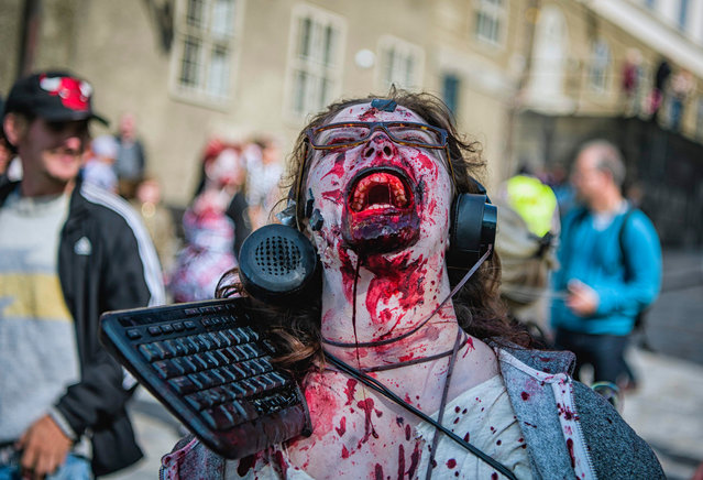 A woman dressed up as a zombie participates in a zombie walk in Stockholm, Sweden on August 19, 2017. (Photo by Jonathan Nackstrand/AFP Photo)