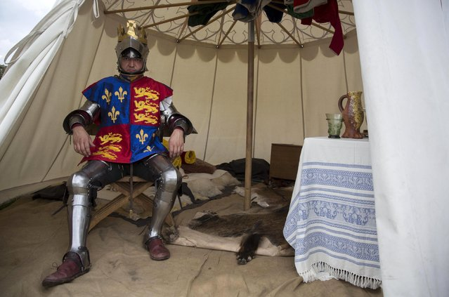 Historical re-enactor Andreas Wenzell poses dressed as Britain's King Richard III in a living history camp during an anniversary event for the Battle of Bosworth near Market Bosworth in central Britain August 22, 2015. (Photo by Neil Hall/Reuters)