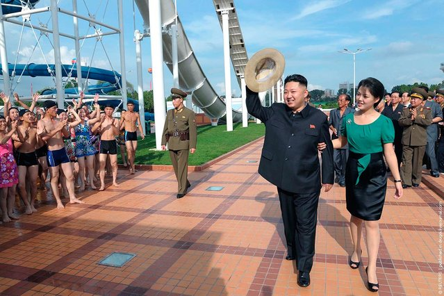 North Korean leader Kim Jong-Un and his wife Ri Sol-Ju attend the opening ceremony of the Rungna People's Pleasure Ground on Rungna Islet along the Taedong River in Pyongyang in this July 25, 2012 photograph released by the North's KCNA to Reuters on July 26, 2012. The Rungna People's Pleasure Ground has attractions such as a dolphinarium, a wading pool, a fun fair and a mini golf course, according to Korean Central News Agency. (Photo by KONA/Reuters)