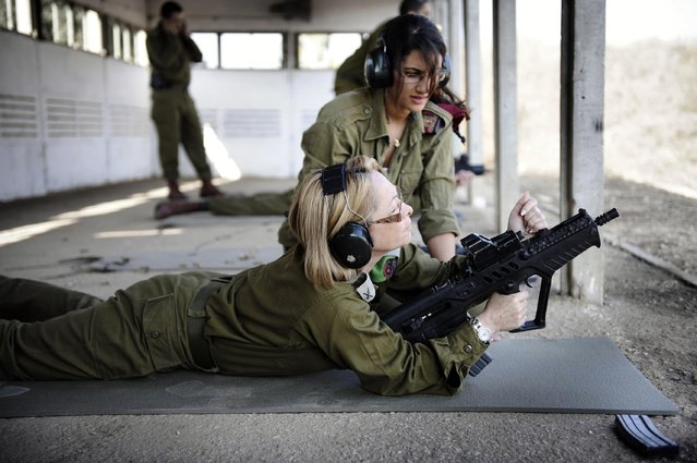 """Women's Affairs Advisor to the Chief of Staff Practices Marksmanship"", November, 2010. Pictured here in the Mitkan Adam base, the Women's Affairs Advisor to the IDF Chief of Staff, Brigadier General Gila Kalifi-Amir, practices her marksmanship skills with the guidance of a Marksmanship Instructor during an event for IDF staff officers. The Women's Affairs Advisor to the Chief of Staff is responsible for addressing the unique needs and successful integration of female soldiers into the IDF. She heads the Women's Affairs Advisor unit whose responsibilities include: research, information and advocacy for women serving in the IDF, professional guidance regarding women's affairs, and the representation of the IDF's female soldiers to the media and to the general public."