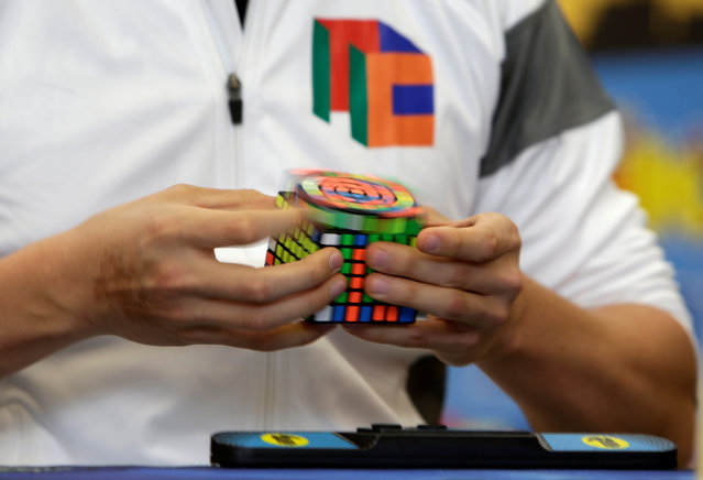 A competitor solves a Rubik's cube during the Rubik's Cube European Championship in Prague, Czech Republic, July 15, 2016. (Photo by David W. Cerny/Reuters)