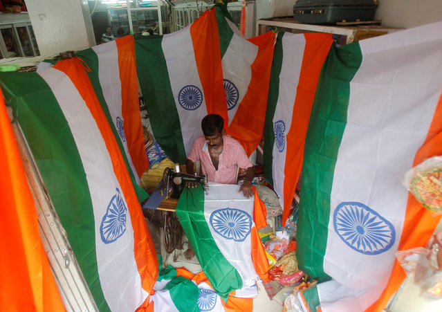 A worker stitches national flags at a workshop ahead of India's Independence Day celebrations in Agartala, India August 2, 2016. (Photo by Jayanta Dey/Reuters)