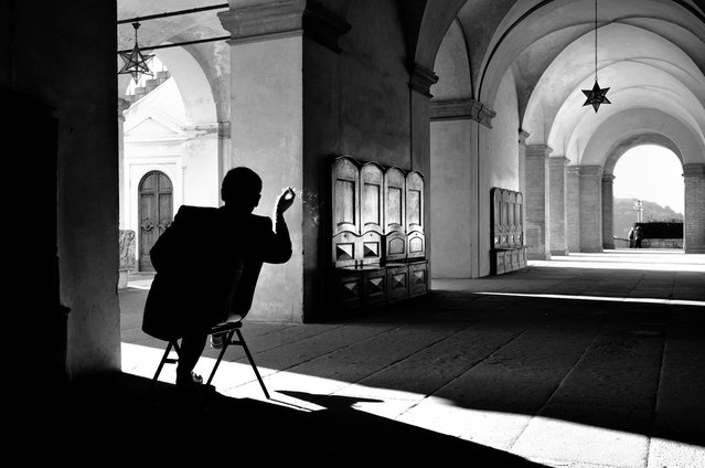 Relax: Photo taken of the guardian of the Medici's Villa at Poggio a Caiano, in Italy, where at the end of the working day he is allowed a cigarette. (Photo by Giacomo Baldi/National Geographic Photo Contest