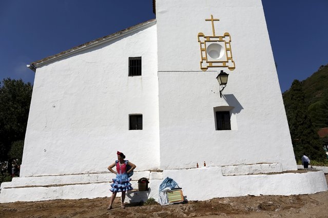 A pilgrim wearing traditional dress stands during the Queen of Angeles pilgrimage in Alajar, southern Spain, September 8, 2015. (Photo by Marcelo del Pozo/Reuters)