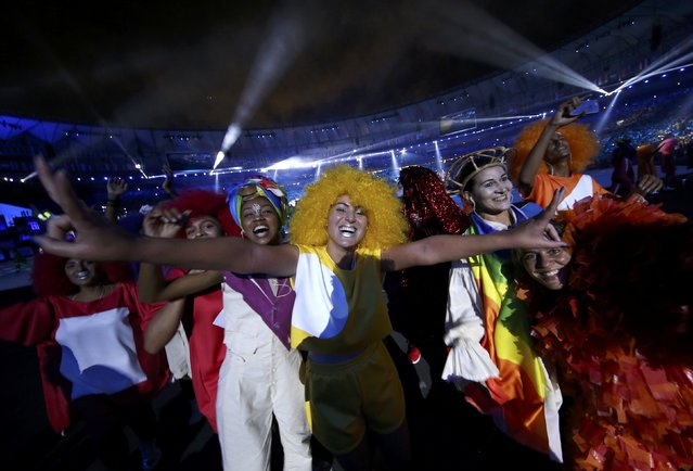 2016 Rio Olympics, Opening ceremony, Maracana, Rio de Janeiro, Brazil on August 5, 2016. People celebrate as they take part in the opening ceremony. (Photo by Damir Sagolj/Reuters)