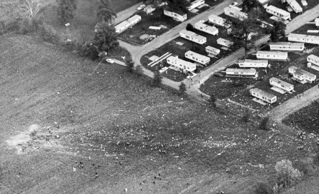 Fragments of an Allegheny Airlines Flight 853, a DC9-30 from Boston which carried 78 people and a crew of four, make a path from the point of impact at left, to the edge of the Shady Park trailer court in Fairland, Ind., September 9, 1969. The Allegheny flight collided with a Piper Cherokee, a smaller plane, which was being flown solo by a student pilot. (Photo by Larry Stoddard/AP Photo)