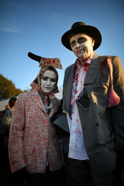 Visitors to the Shocktober Fest dressed as zombies pose at Tulleys Farm  on October 6, 2012 in Turners Hill, England. People dressed as zombies from around the United Kingdom have converged on Tulleys Farm in an attempt to set a new Guinness World Record for the most zombies together in one place.  (Photo by Peter Macdiarmid)
